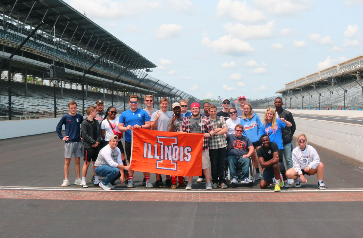 RST class posing at the finish line at the Indianapolis Motor Speedway