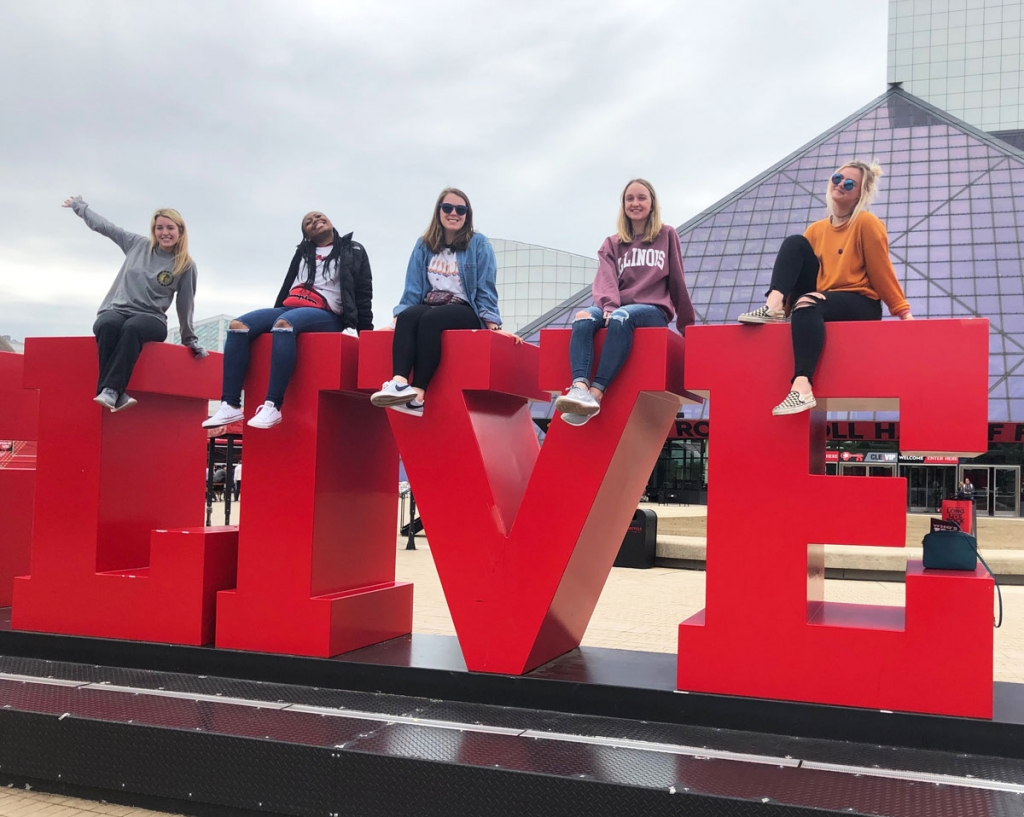 RST posing with Rock & Roll Hall of Fame sign