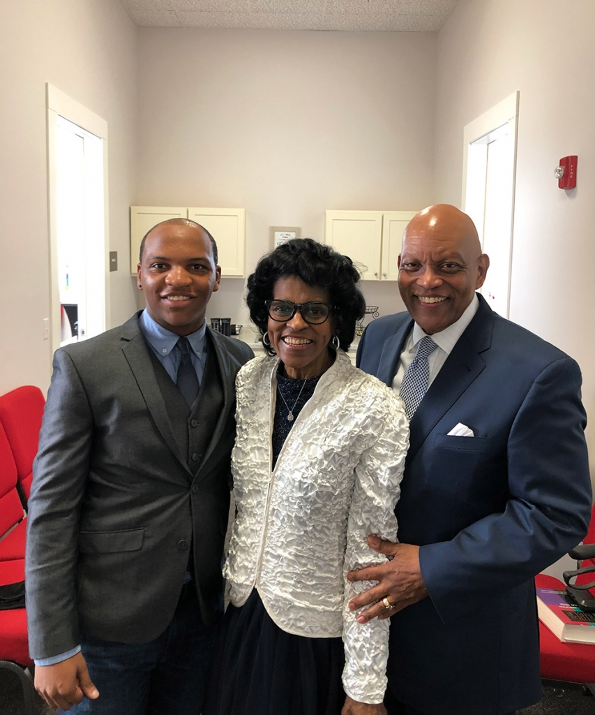Damonte with his pastor and his wife