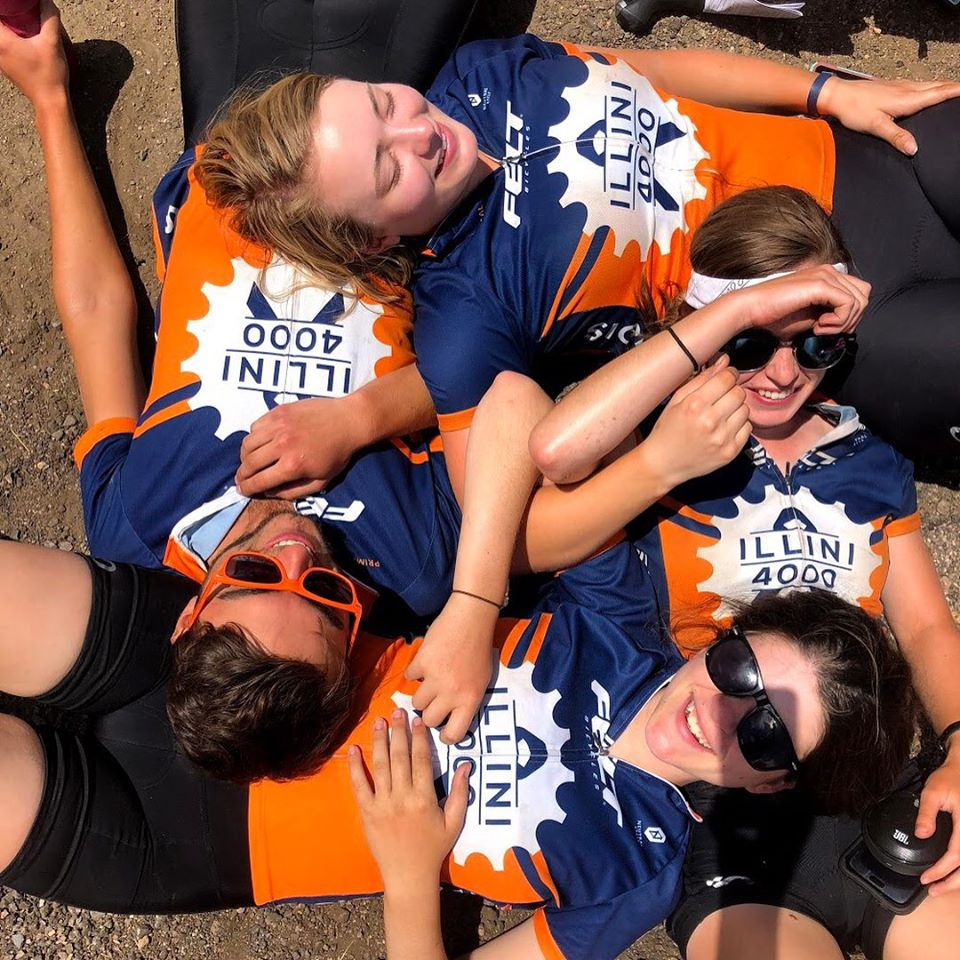 Illini 4000 team members resting in an interlocking pattern over top one another