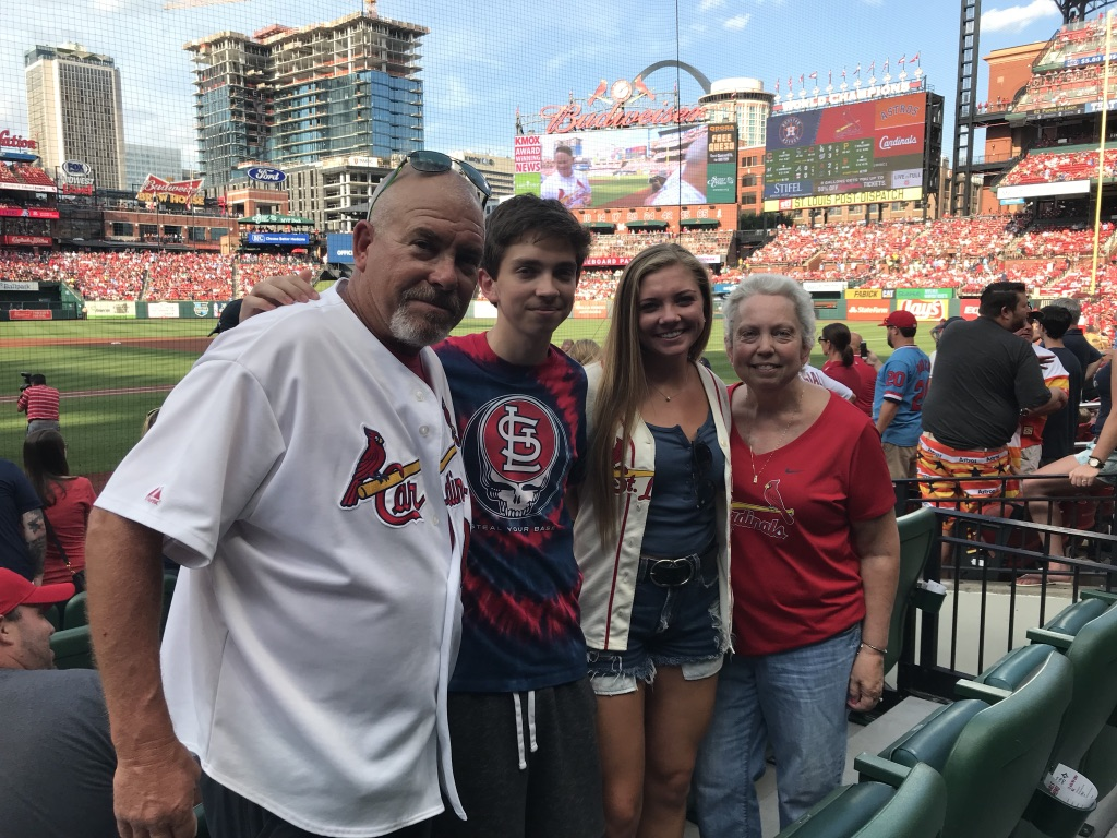 Rachel with her family at a Cardinals baseball game