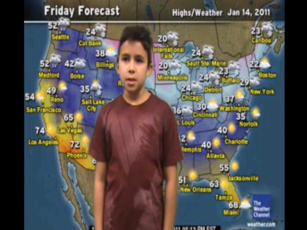 Brandon, pictured as a child, in front of a TV screen showing the weather.