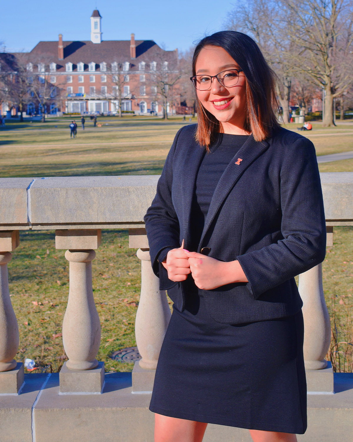 Alexis posing for a campaign photo on the quad.
