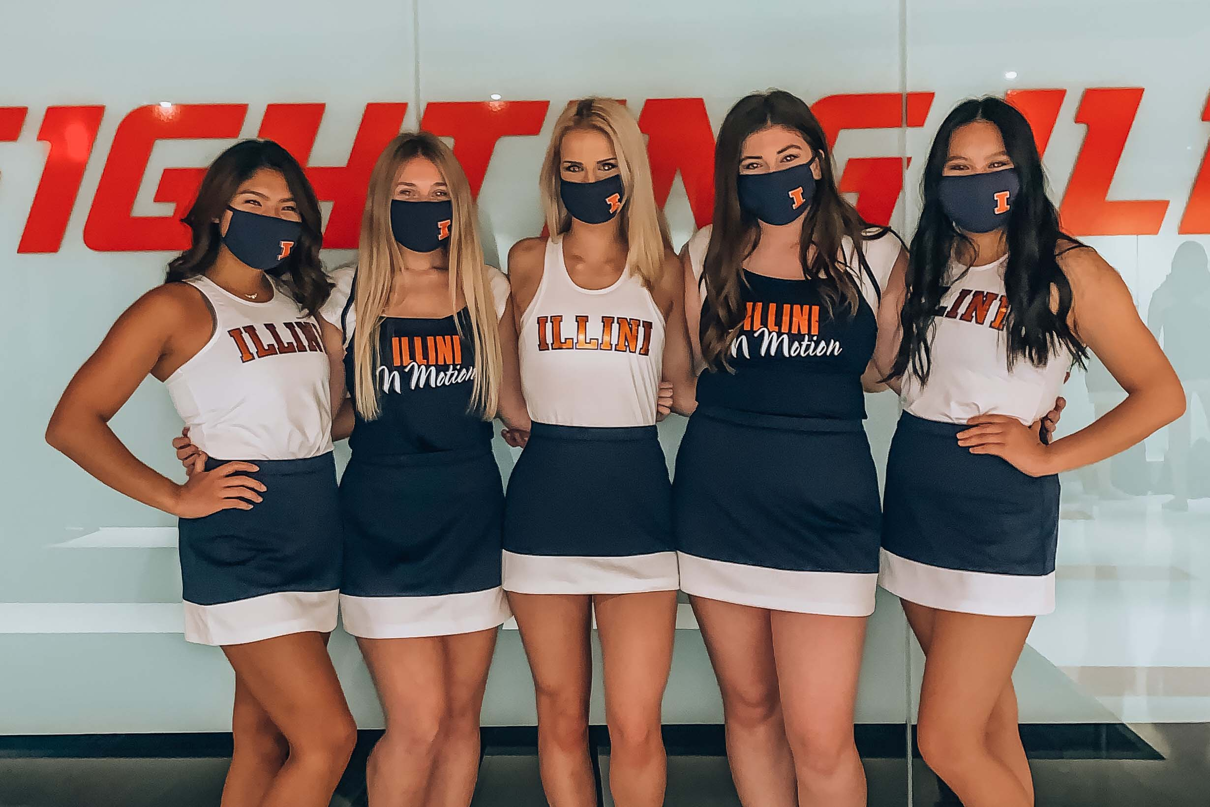 Claire and her dance team wearing face coverings at an event.