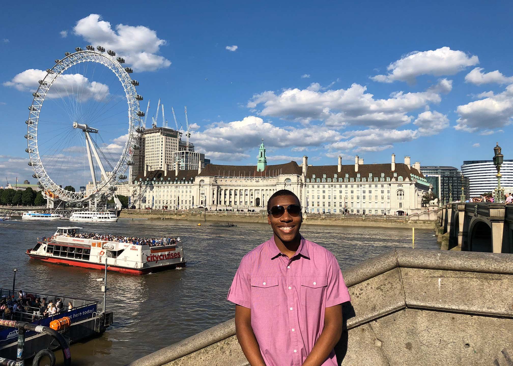 Michael enjoying his time in London in front of the London Eye.